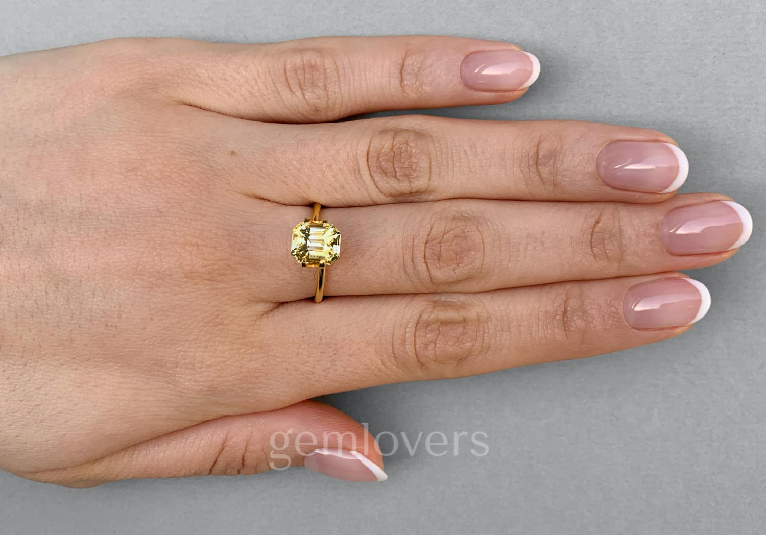 Radiant cut natural yellow sapphire ring