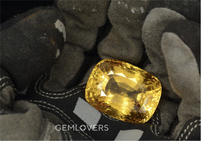 a large sample of faceted gem-quality corundum of top Golden color