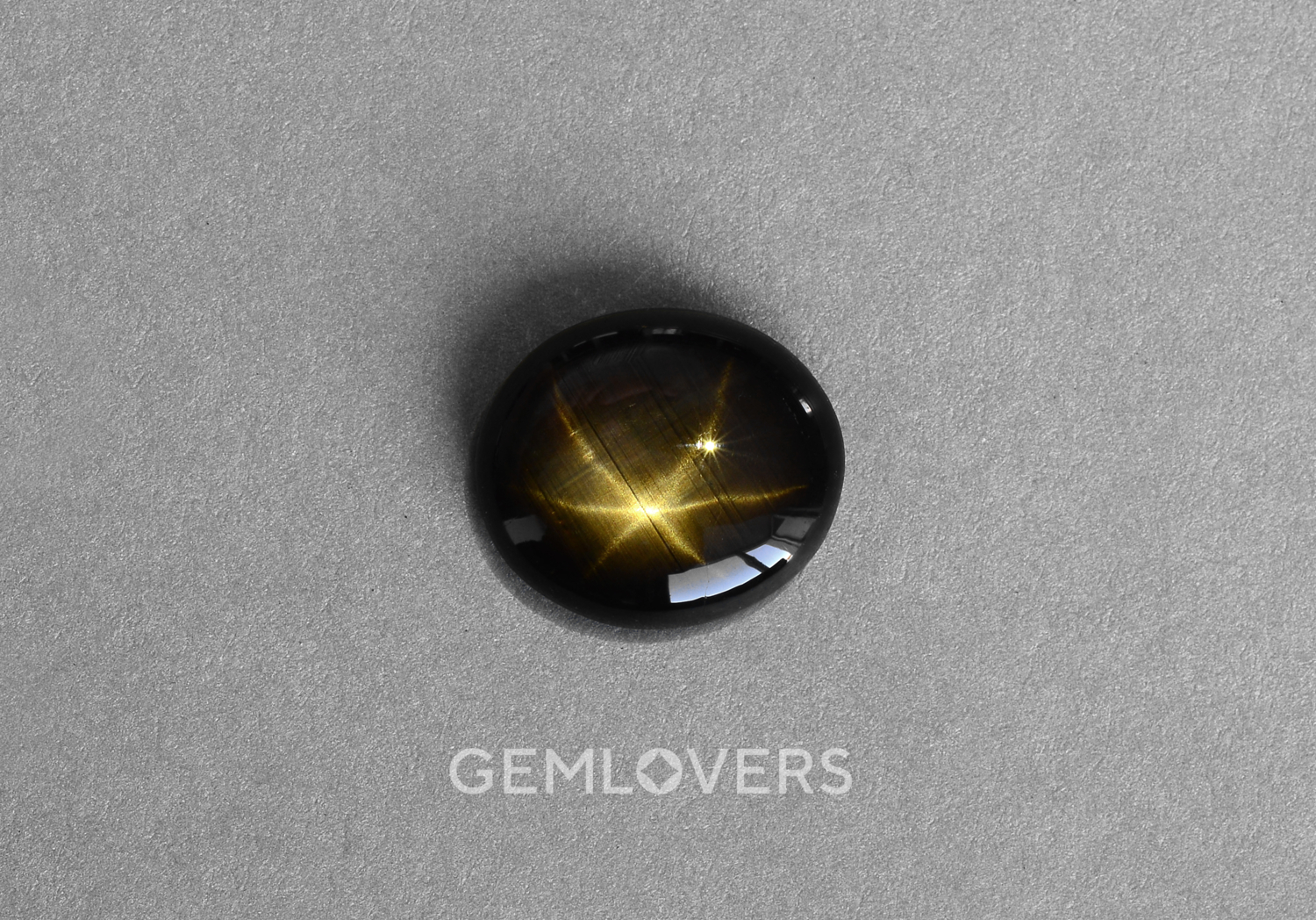 Black sapphire stone with a star