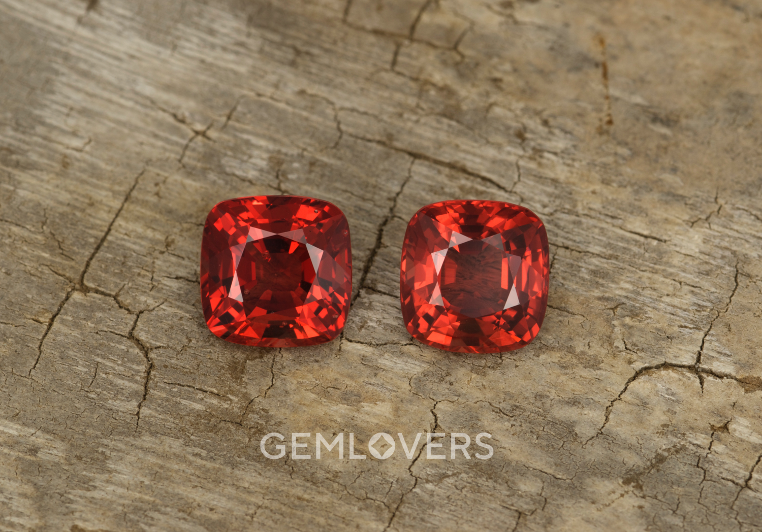 A pair of red-orange spinels