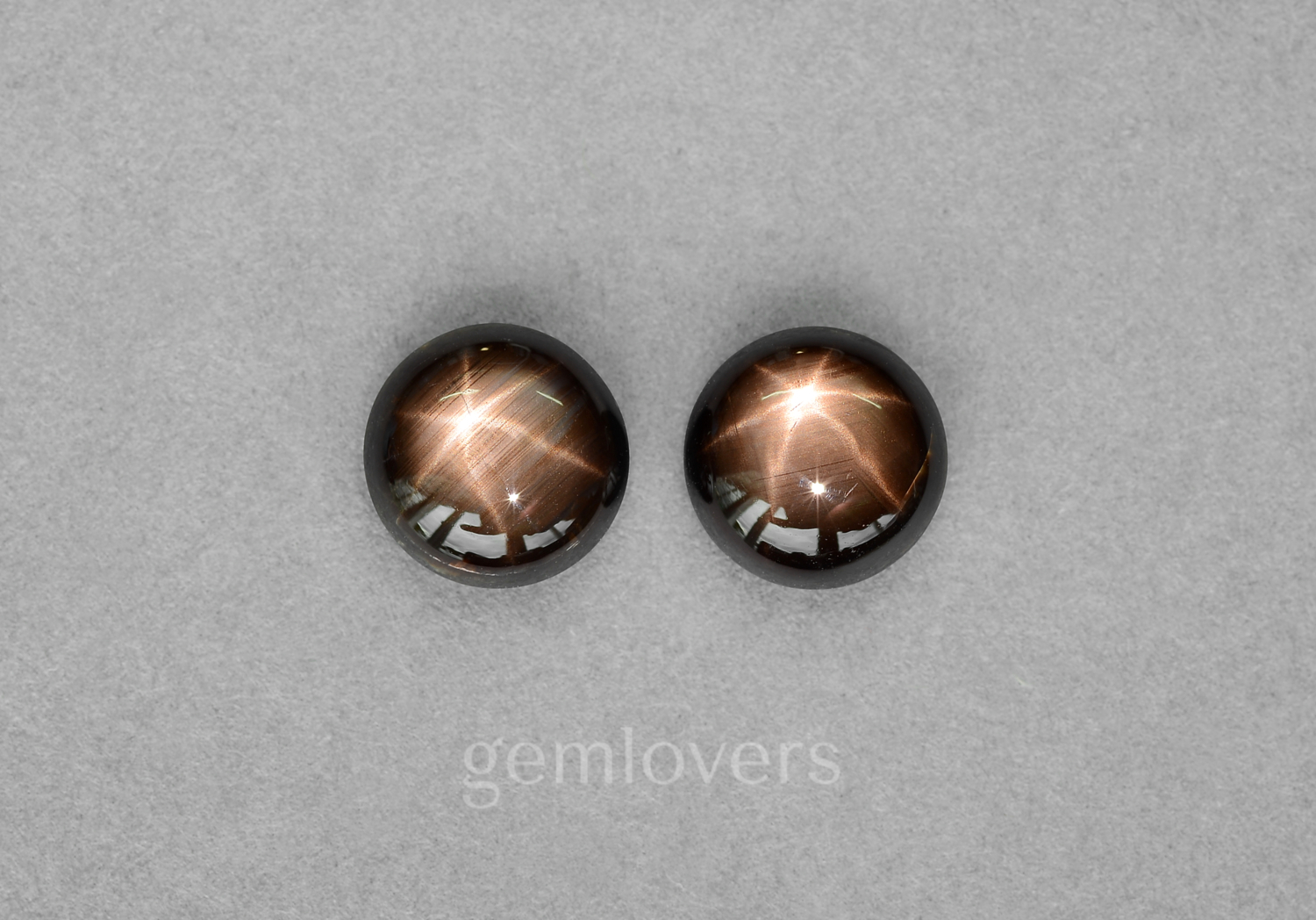 Pair of round sapphires with asterism