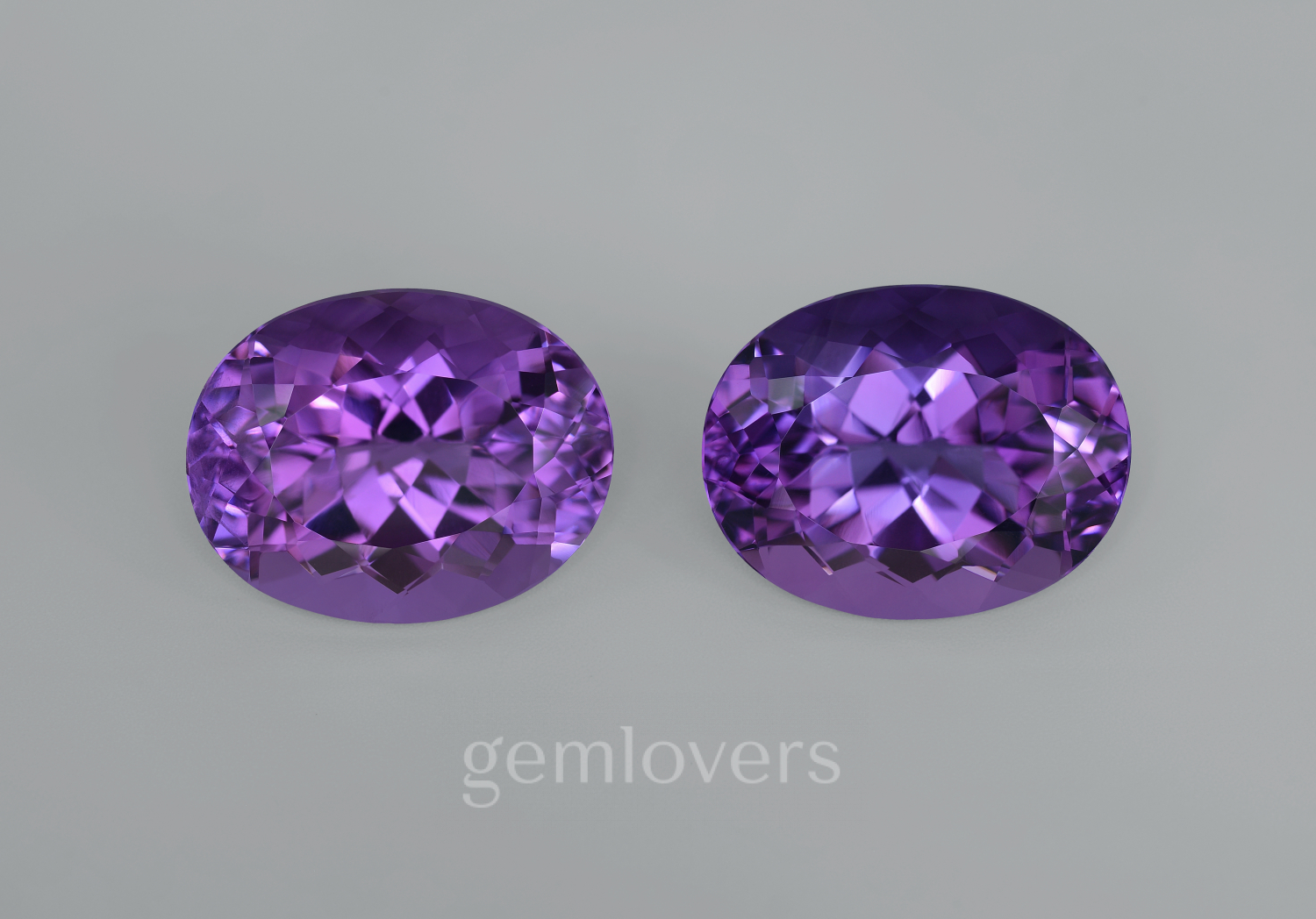 Pair of large oval cut amethysts