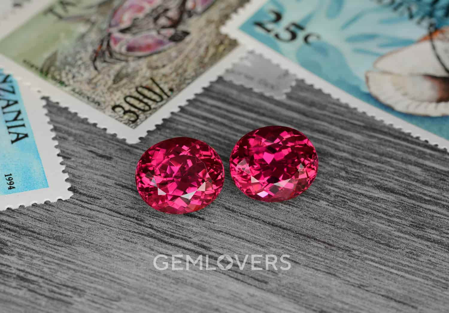 a pair of faceted vivid pink-red color rubellite