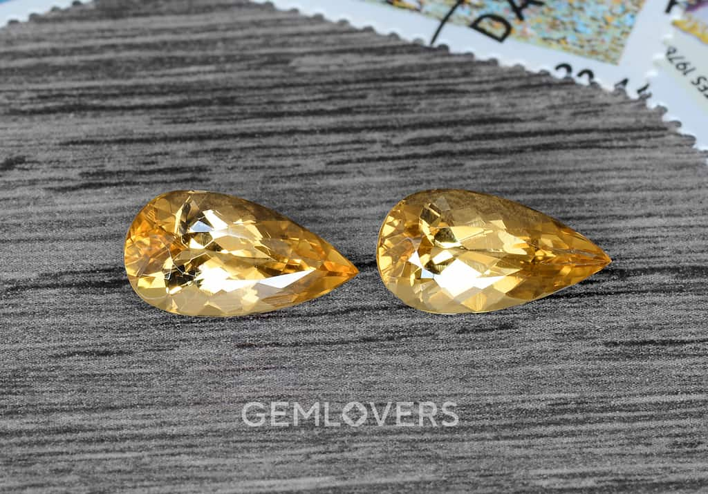 pair of faceted topazes in the form of elongated pears