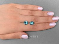 hand with Pair of oval cut aquamarines