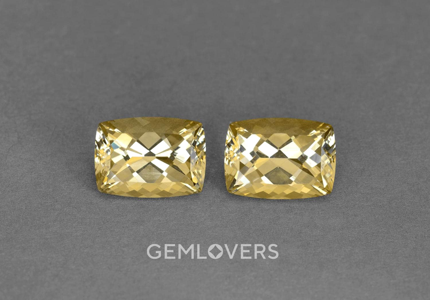 a pair of faceted medium-sized heliodors